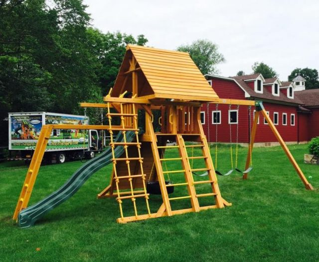 Supreme Backyard Cedar Swing Set with Wood roof