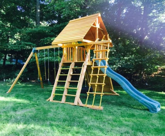 Supreme Backyard Swing Set Installed with wood roof