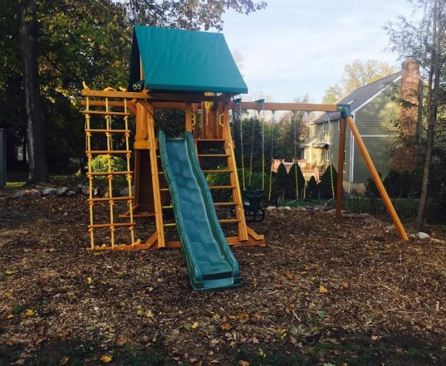 Supreme Outdoor Swing Set Installed in Wood Mulch