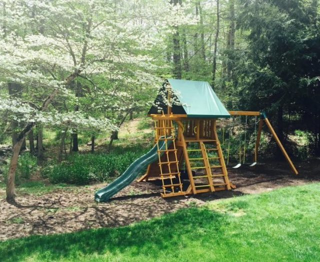 Supreme outdoor Swing Set Installation under tree