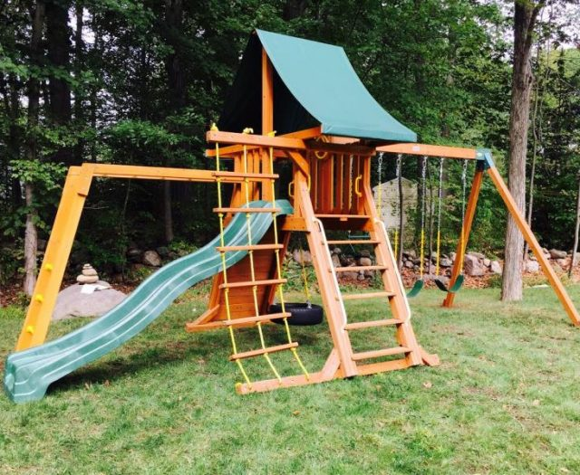 Supremescape backyard swing set installed with monkey bars