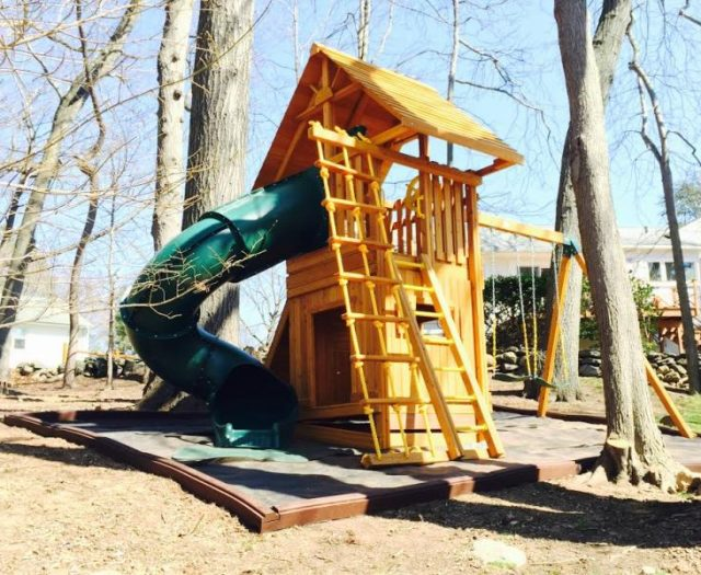 Ultimate Backyard Cedar Playset Installed on Sloped Backyard