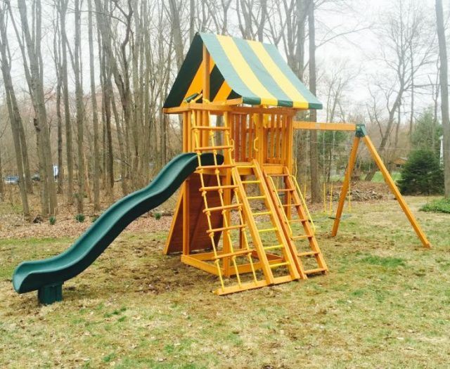 Ultimate Outdoor Cedar Swing Set Installed with Step Ladder