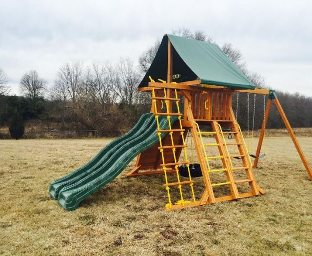 Cedar Supreme Playset with two green wave slides