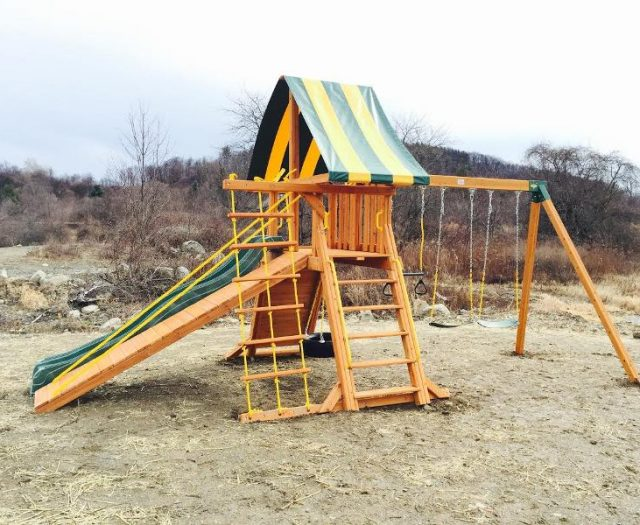 Cedar Supremescape Jungle Gym installed with gang plank and wave slide