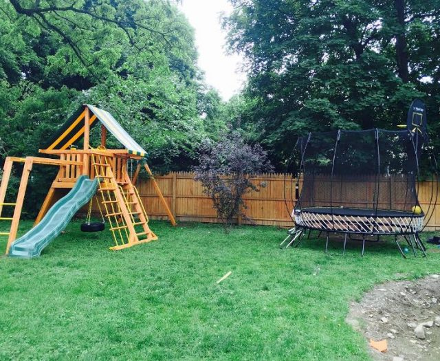 Cedar Supremescape Playset Installed in Backyard with Springfree Trampoline