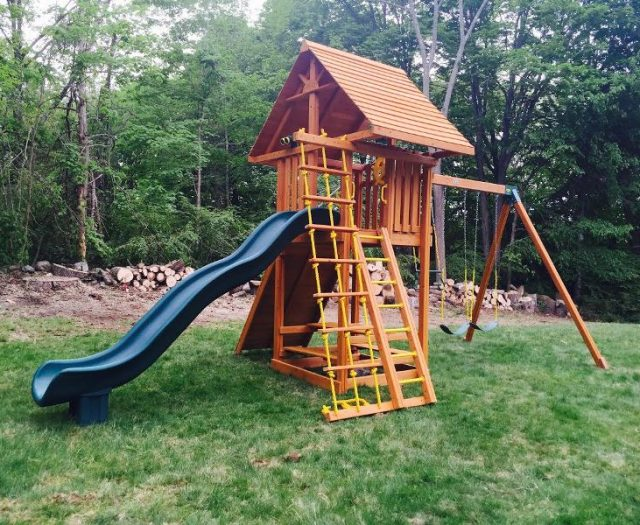 Cedar Ultimate Swing Set with wood roof and picnic table