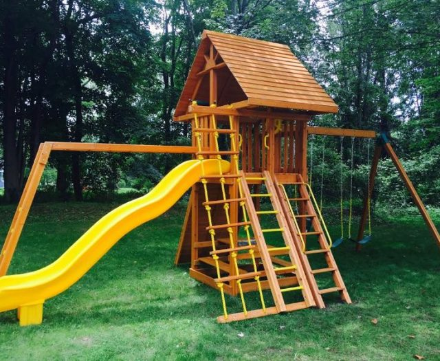 Cedar ultimate playset with picnic table and monkey bars