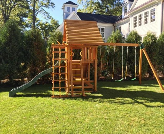 Dream Cedar Outdoor Playset and built in picnic table and cedar wood roof