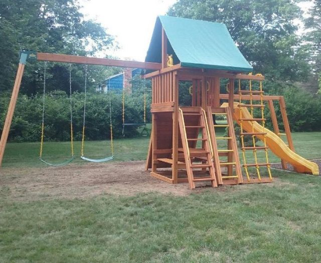 Dream Outdoor Cedar Swing Set with green tent picnic table and monkey bars