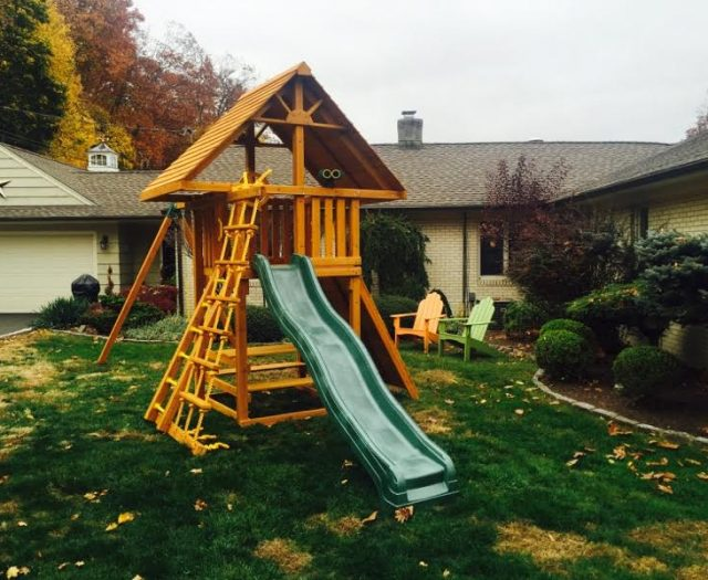 Dream Outdoor Swing Set with picnic table and wood roof