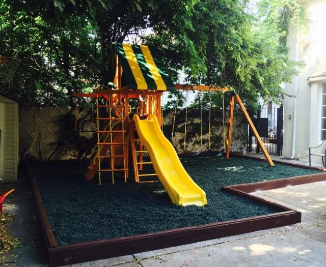 Dreamscape Cedar Swing Set installed in Green Rubber Mulch with Wooden Step Ladder