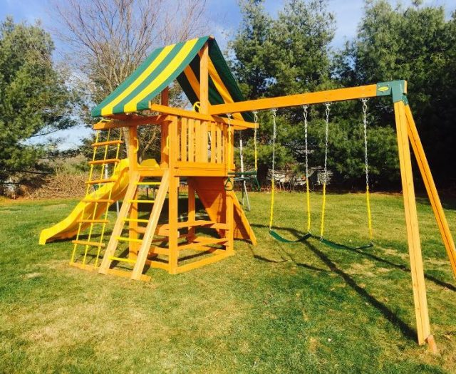 Dreamscape Cedar Swing Set with built in picnic table and rock wall