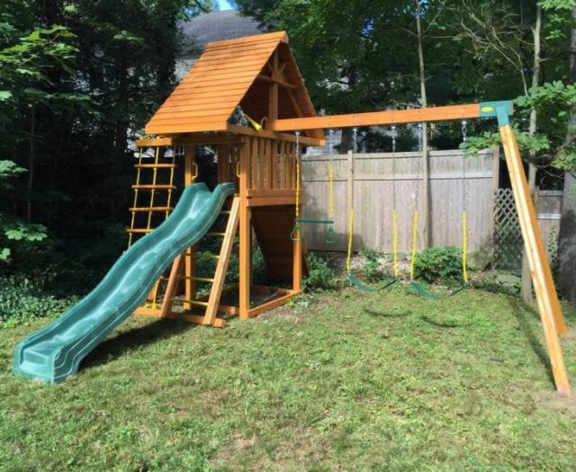 Dreamscape Playset Delivered and Installed in Backyard with cedar wood roof