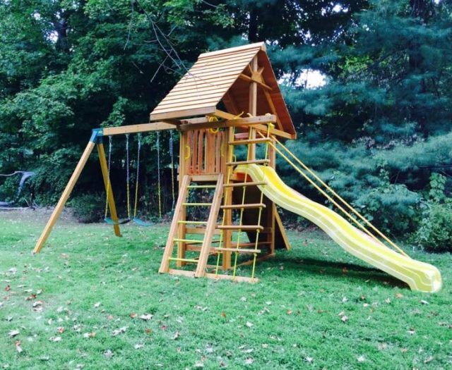 Dreamscape Swing Set Installed with Cedar Wood Roof and built in picnic table