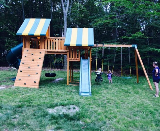 Fantasy Backyard Cedar Swing Set Installed in Backyard with happy customers