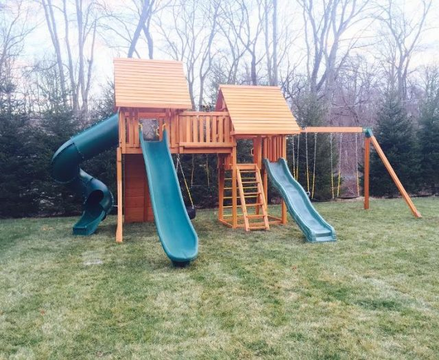 Fantasy Cedar Playset with Wood Roof and green wave slide