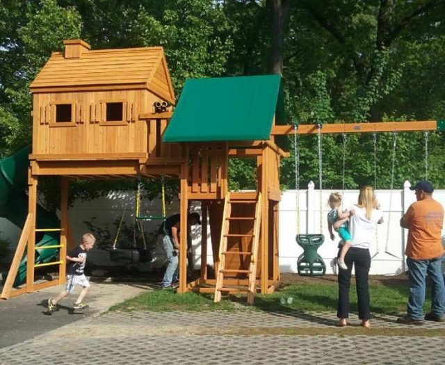 Fantasy Tree House Backyard Playset Installed in backyard with Happy Family