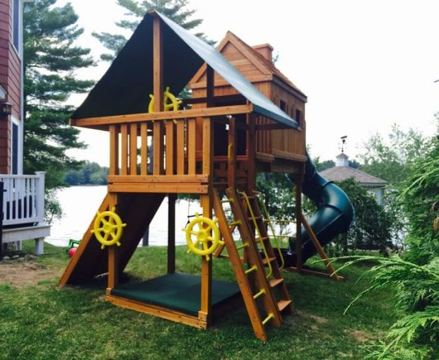 Fantasy Treehouse Backyard Playset installed in backyard with extra ships wheels