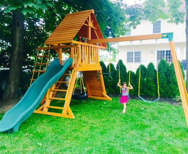 Happy Children Enjoy their new Suprmemscape Swing Set with Cedar Wood Roof