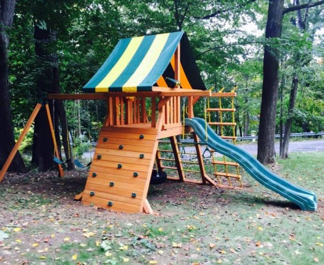 Supreme Cedar Playset Built on Sloped Backyard