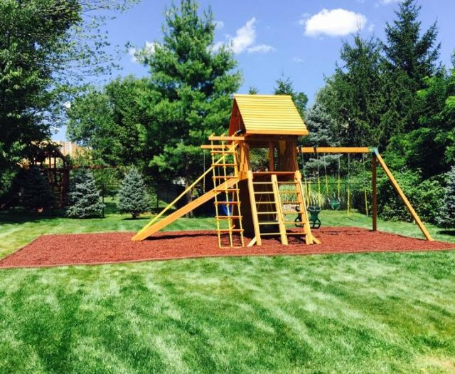 Supreme Outdoor Playset with gangplank installed in Rubber Mulch