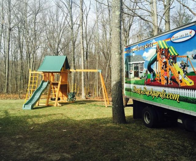 Supreme Swing Set installed in Backyard with truck
