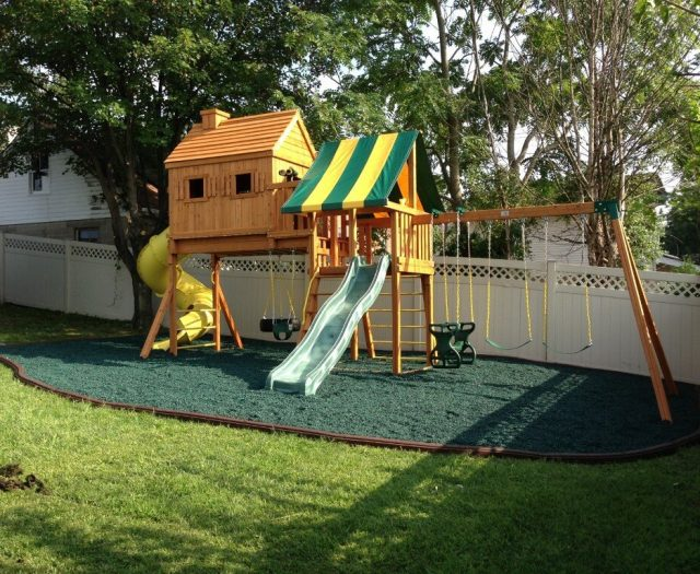 Fantasy Tree House Swing Set Installed with Green Rubber Mulch