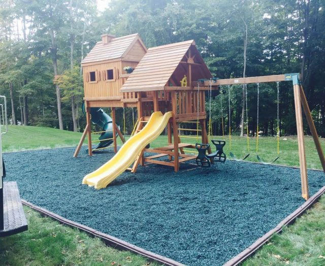 large kids playsets with blue rubber mulch