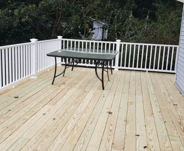 natural wood decking with railing