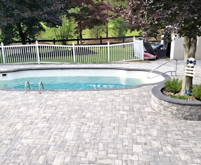Grey Stone Patio Around Pool in New York