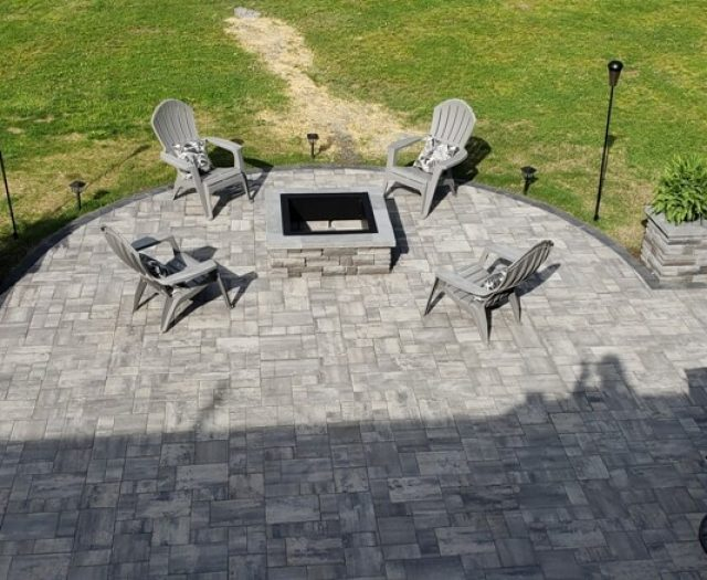 Grey granite stone patio and outdoor fireplace