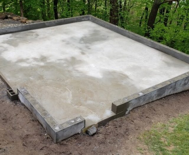 base for concrete pad preparation in backyard