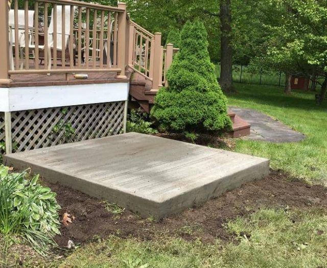 concrete pad in backyard for family hottub experience