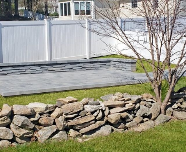 grey stone patio in backyard for summer (1)