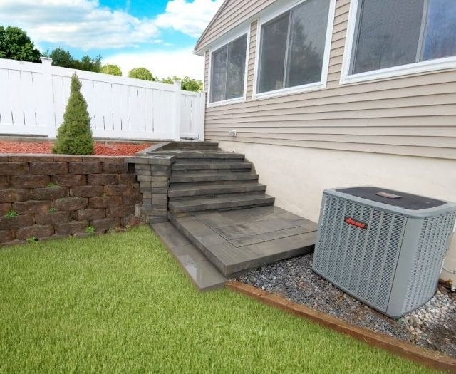 grey stone steps leading to patio in backyard for summer