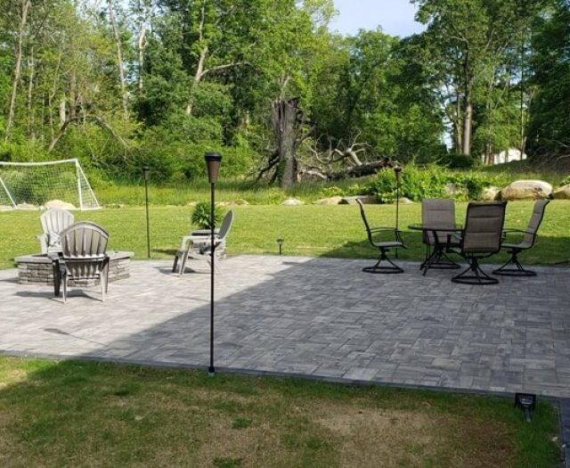 outdoor firepit with grey granite patio for summer fun