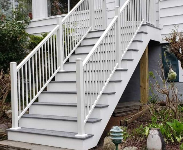 11 stairs with white railing leading to house