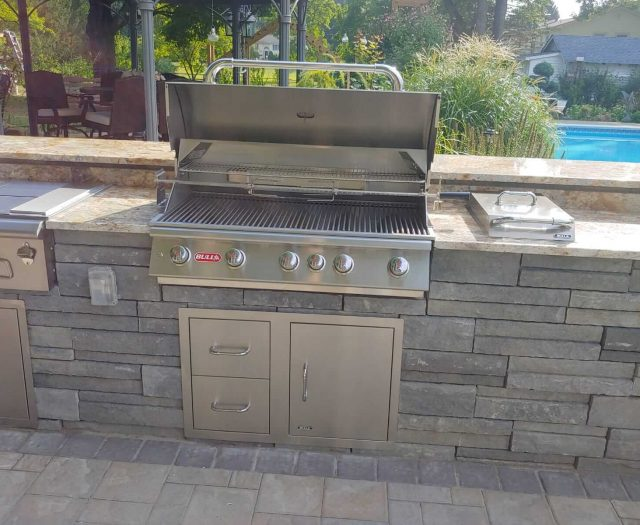 Brahama Bull Grill head in custom island with fridge and side burner