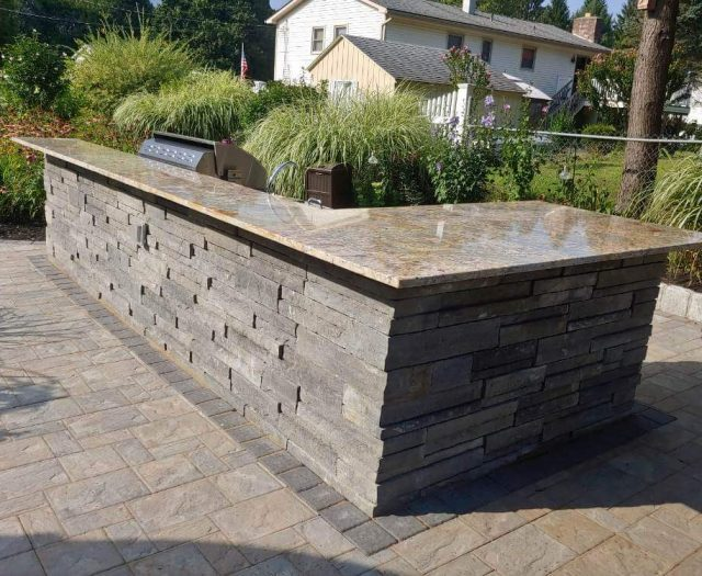 Custom Outdoor Kitchen Island with Granite Countertop