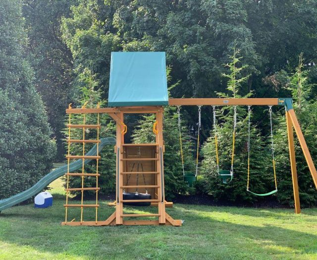 Dreamscape swing set with green canopy