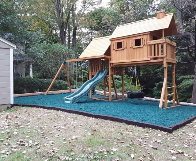 Fantasy Tree House with green mulch by eastern jungle gym
