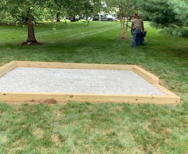 backyard with gravel pad ready for shed
