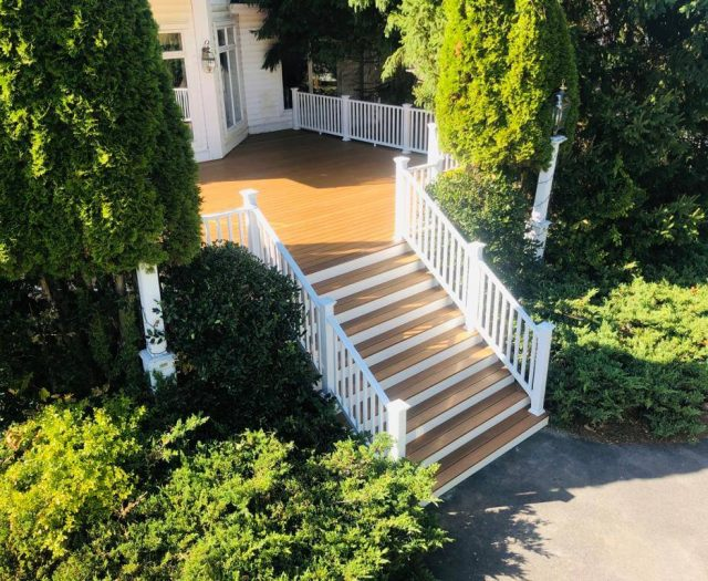 renovated newtec teak front steps leading to new deck