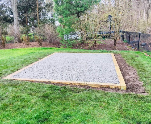 shed gravel pad on slight inclined backyard