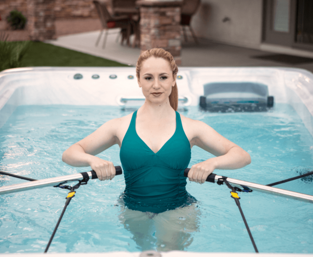 exercise with rowing in artesian exercise pool and swim spa