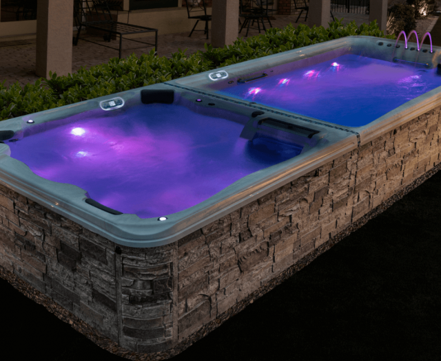 purple lights illuminate water in artesian exercise pool