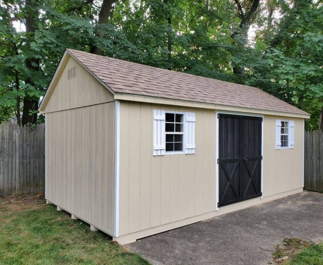 A-Frame Backyard Shed with Black Double Door and White Trim