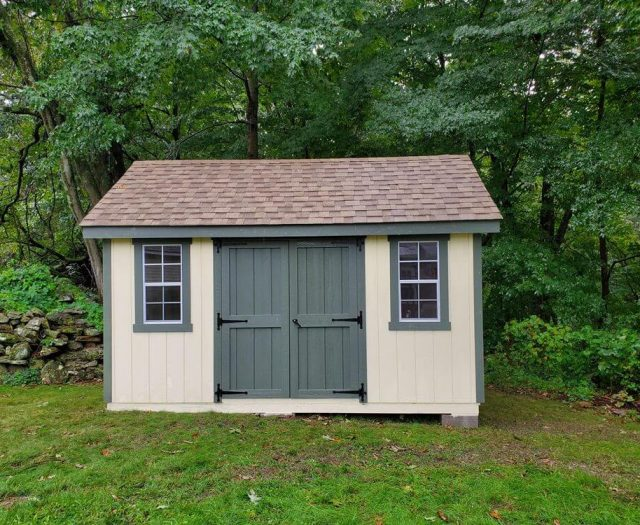 A- Frame Backyard Shed with Yellow T-11 Siding, Dk. Green Double Door and Trim