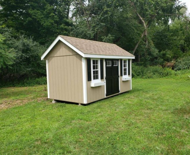 A-Frame Shed with Beige T-111 Siding, White Trim and Flower Boxes, and Black Shutters and Double Door